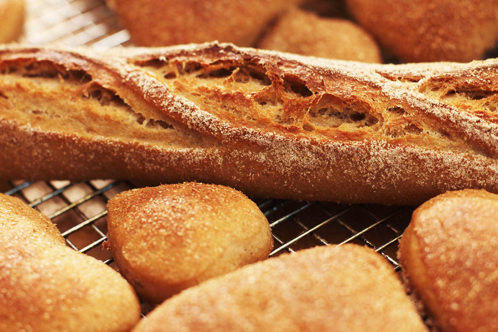 Various breads on a cooling rack