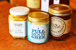Jars of Full Moon Ghee, Cheshire Garden Garlic Mustard and Acorn Kitchen Preserves